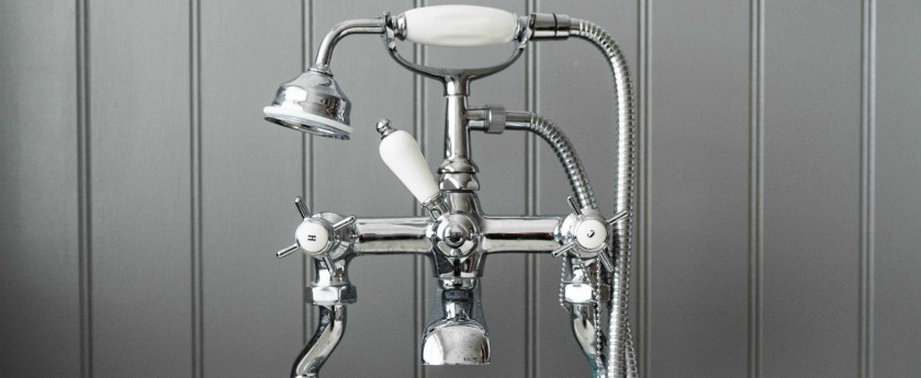 Bathtub faucet with hot and cold indicators in chrome.